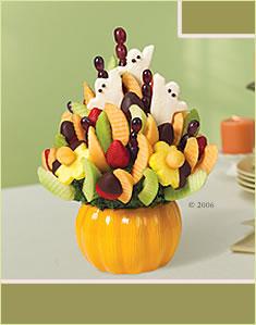 Halloween Celebration half dipped strawberries & pineapple